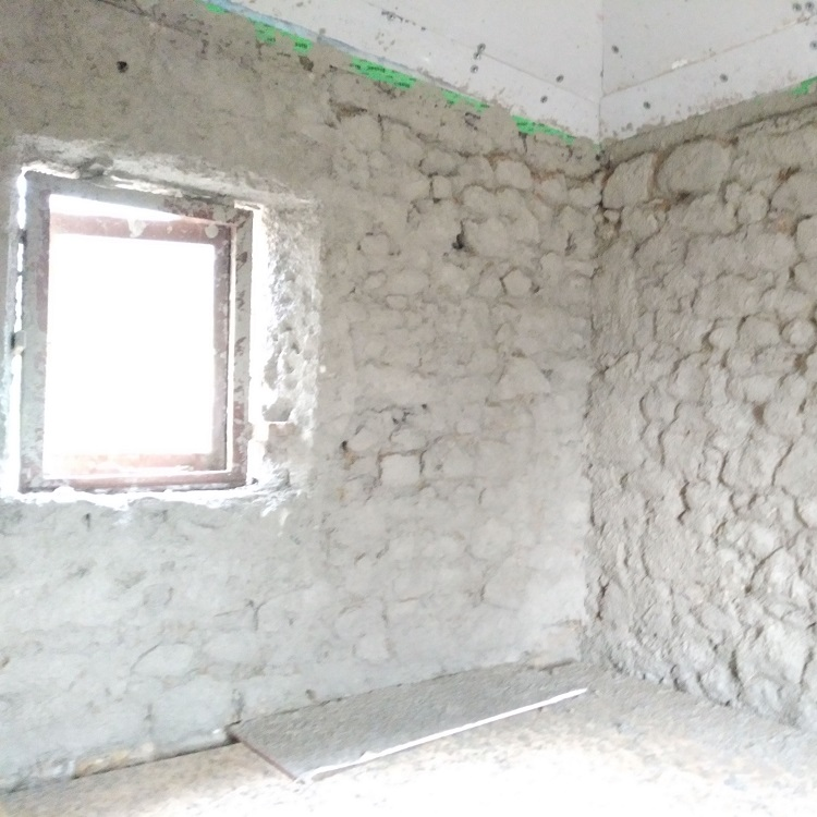 Harling coat using traditional lime plaster