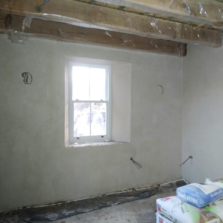 Traditional lime plastering - finish coat